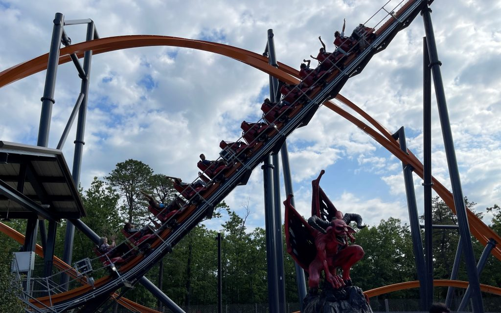 Jersey Devil Coaster on Lift With Statue